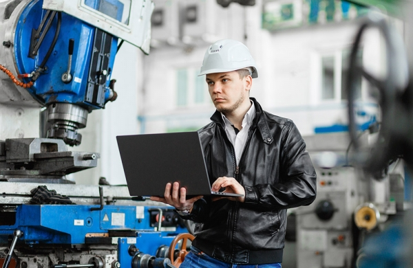manager overseeing machine work performance