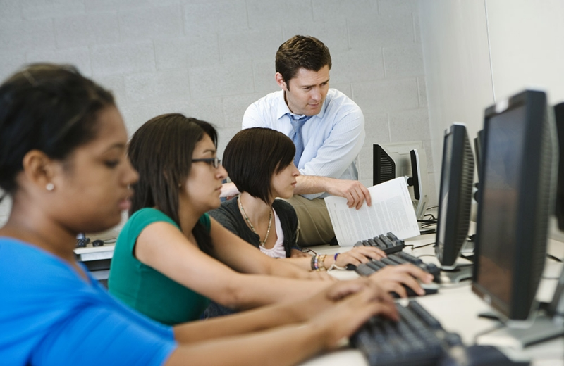 professor helping student with computer task