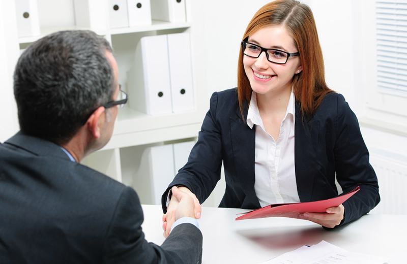 two individuals shaking hands after successful interview