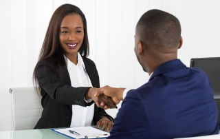 two individuals shaking hands prior to an interview